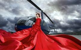 Menina chinesa, vestido vermelho, helicóptero