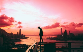 Preview wallpaper City, sunset, sea, man, fence