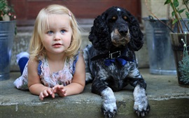 Cute little girl and dog, friends