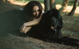 Girl and black dog