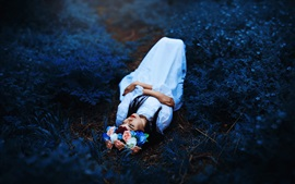 Girl sleep on ground, flowers, wreath