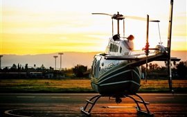 Helicopter at sunset airport