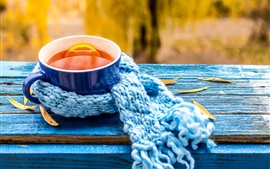 Lemon tea, blue cup, scarf