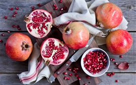 Preview wallpaper Pomegranate, knife, fruit photography