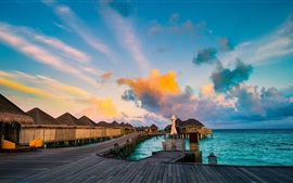 Preview wallpaper Resorts, coast, sea, huts, clouds