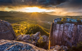 Preview wallpaper Rocks mountain, forest, trees, sunrise, sun rays
