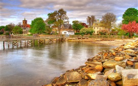 Town, houses, stones, pier, trees, clouds, lake