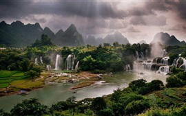 Preview wallpaper Waterfalls, river, mountains, trees, clouds, sun rays