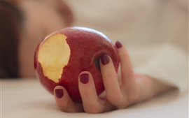 Preview wallpaper A red apple in hand