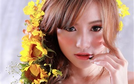 Preview wallpaper Asian girl, face, yellow flowers