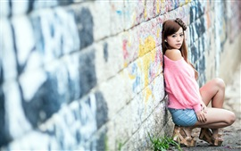 Preview wallpaper Asian girl, pink clothes, back to the wall