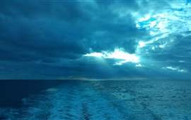 Preview wallpaper Blue sea, clouds, sun rays, dusk
