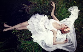 Preview wallpaper Bride lying on grass, white dress