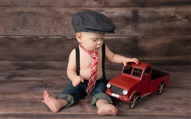 Cute baby, boy play toy car