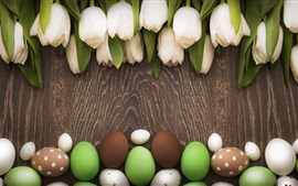 Easter theme, white tulips, colorful eggs, wood board