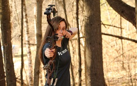 Girl use compound bow, archery, forest