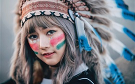 Preview wallpaper Indian style, girl, face, headdress, feathers, paint