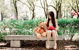 Preview wallpaper Long hair Asian girl, teddy bear, bench