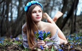 Preview wallpaper Lovely girl and blue flowers, lying on ground