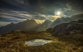 Mountains, grass, water, puddle, sunset, clouds