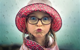 Preview wallpaper Playful child girl, face, hat, glasses