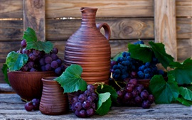 Purple grapes, bottles
