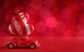 Red car, large love heart, bokeh