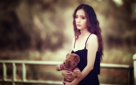 Sadness Asian girl, teddy bear