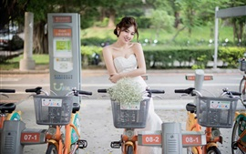 Preview wallpaper Smile Chinese girl, street, bikes