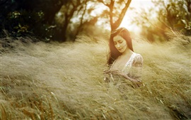 Summer girl in nature, grass, wind
