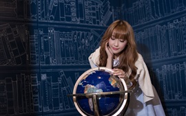 Asian girl and globe