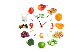 Creative clock, vegetables, fruit, white background
