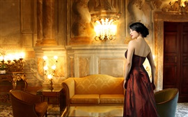 Elegant girl, red clothing, furniture, lights, decoration