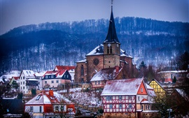 Germany, Thuringia, church, houses, town, trees, winter, dusk