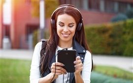 Preview wallpaper Smile girl use tablet, headphones