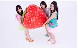 Preview wallpaper Three Asian girls and big strawberry