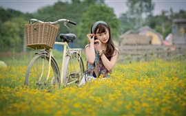 Preview wallpaper Young girl, bike, flowers, Asian