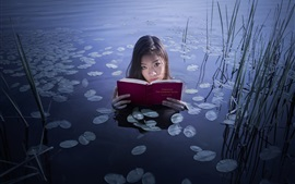 Asian girl read book in the lake