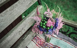 Bouquet flowers, wood bench