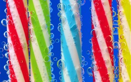 Preview wallpaper Colorful stick candy in water, bubble