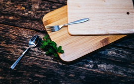 Cutting board, fork, spoon, mint leaves