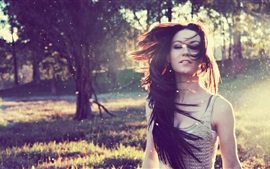 Preview wallpaper Girl hair flying, wind, nature, trees, sunshine