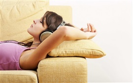 Preview wallpaper Girl lying on sofa, headphones