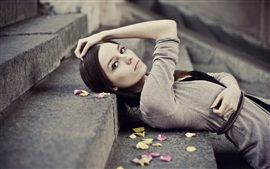 Preview wallpaper Girl lying on steps, leaves, pose