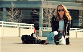 Preview wallpaper Girl sit on ground, jeans, jacket, sunglasses