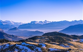Mountains, snow, trees, blue sky