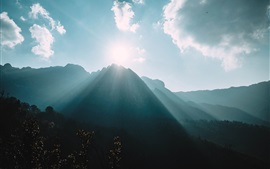 Preview wallpaper Mountains, sun rays, fog, clouds, sky