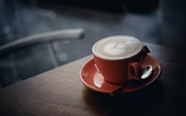Um copo de café, cappuccino, espuma