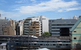 Preview wallpaper Railway, train, Shinkansen, city, buildings, Tokyo, Japan