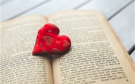 Red cloth love heart, book